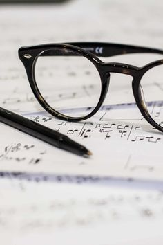 Free stock photo of pen, notes, music, glasses