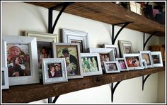 http://www.simpleorganizedliving.com/2012/03/08/simple-ways-to-decorate-with-photos/ photo shelf by Andrea Dekker, via Flickr