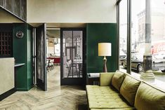 Housed in a an old 1929 office buildings, The Robey, designed by Belgian Nicolas Schuybroek Architects and Marc Merckx Interiors with a mix of vintage on custom made pieces, is Mid-century noir-cool with a touch of art deco.