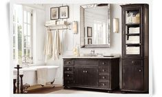 black vanity with silver mirror and black accents