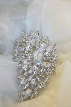 Rhinestone Brooch - Crystal Brooch Pin - Vintage Style Brooch- Perfect For Bridal Wedding Bouquets - Bridal Sash   This listing is for 1 Beautiful Rhinestone Crystal brooch. The setting is silver tone. This elegant brooch has such a sparkling beauty to it Vintage Style. This Brooch can be used for Bridal bouquets, Ring Bearer Pillow, Bridal Sash, Bridesmaid Sash, add it to a Hair Comb, and or even some Ribbon to make a Headband for your Special Event. This Sparkles and Shines so Beautiful…
