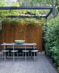 Climbing vegetables such as squash, runner beans, cucumbers, and grapes can be grown up and over a backyard pergola. Faye Toogood Pergola in London Garden T Magazine Patio Pergola, Modern Pergola, Pergola Plans, Cheap Pergola, Metal Pergola, Black Pergola, Metal Roof, Modern Patio, Pergola Shade