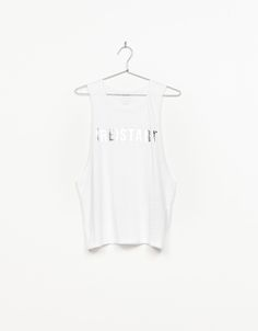 Strappy sport top with metallic text. Discover this and many more items in Bershka with new products every week