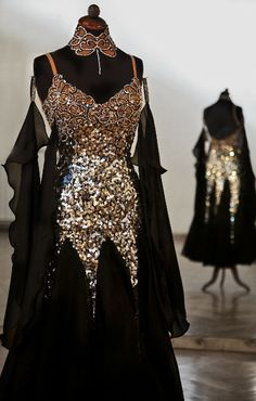 Black standard dress with extensive sequence and stoning from Couture Body Movement. Visit http://ballroomguide.com/comp/attire/lady.html for more info about competition attire.