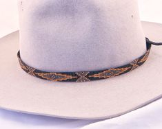 Items similar to Geometric Design Beaded Hatband in Metallic Colors of Dark Gold, Gunmetal, Dark Grey on a Black Background. Great for Straw and Cowboy Hats on Etsy Loom Bracelet Patterns, Bead Loom Bracelets, Bracelet Crafts, Bead Loom Patterns, Beading Patterns, Beading Ideas, Beading Projects, Western Hats, Cowboy Hats