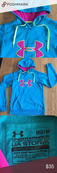 UA Storm hoodie. ⭐️ Great blue color UA hoodie with neon green hood ties and traditional UA logo.  In great condition.  Semi fitted Storm. Under Armour Jackets & Coats