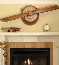 World War I Propeller Wall Hanger, really unique vintage aviation decor.  $295  Not everybody has the front of a plane coming out of their wall!