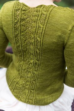 Cosette is a sweet, lovely cardigan as fresh as spring. I named it Cosette because I was listening to Les Miserables while knitting it. It describes Cosette blooming into a beautiful young woman like the blooming flowers in the garden. The cables transitioning into lace in the stitch pattern is like flowers blooming from the cables.
