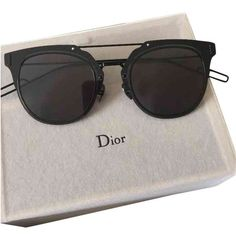 """Dior Composit sunglasses revealed at the Summer 2015 show. Pantos shape with flat dark grey lenses and frame in ultra-thin tone-on-tone black metal. Openwork temples show the emblematic Dior Homme ""cut"". The flat dark grey lenses ensure UV protection. Summer Sunglasses, Black Sunglasses, Ray Ban Sunglasses, Sunglasses Women, Luxury Sunglasses, Sunglasses Accessories, Mirrored Sunglasses, Sunglasses For Your Face Shape, Lunette Style"