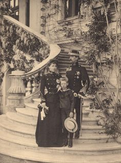 King Ferdinand I, Queen Marie and Carol II of Romania. She was a granddaughter of Queen Victoria & very famous in her time. Her son Carol was terrible to her when he became King & was deposed for a lot of reasons.