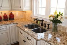 Giallo Ornamental granite kitchen countertops white kitchen cabinets double sink