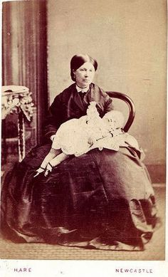 Postmortem photo of grieving mother holding her deceased child (although, admittingly, she is holding it rather awarkardly, it appears to be slipping off her lap).