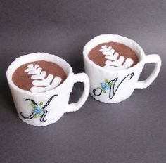 Oh. My. God. Latte cup pin cushions, complete with latte art! Squee worthy