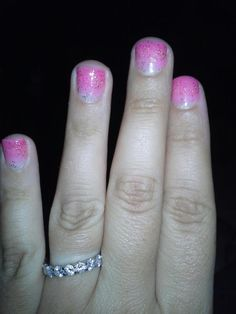 faded pink nails :) just got it done today love it. Its gel strawberry margarita faded out.. so its a light coat double coat in the middle triple on tip then gold glitter :)