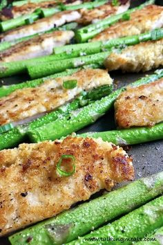 Seriously, what dinner could be easier than cooking everything in the oven on 1 pan?  Nothing! :) This One-Pan Parmesan Crumb Chicken and Asparagus is crispy, healthy, filling, easy, and delicious.  The chicken is simply breaded with a mixture of parmesan cheese and breadcrumbs.  The Asparagus is lightly seasoned with extra virgin olive oil, garlic, salt, and pepper.  Sprinkle with scallions and this dish is loaded delicious-ness! #sheetpan #onepan #dinner #asparagus #chicken #easyrecipe