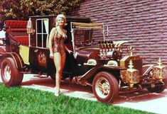 "Marilyn & The Munster's ""Koach"" Designed and built by George Barris made from 3 Model T bodies and is 18 feet long. The 133"" frame was made by hand. Powered by a 289 Ford Cobra engine from a 1966 Mustang GT with a 4 speed manual transmission & a power rear end. The brass radiator and fenders were hand formed. Jahns high compression pistons, ten chrome plated Stromberg carburators, an Isky cam, and had a set of Bobby Barr racing headers.  In 1964, the cost to build the first one was…"