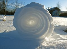 "Snow Roller. ""According to the National Weather Service, snow rollers need just the right combination of light, sticky snow, strong (but not too strong) winds and cold temperatures to form. Like a snowball spinning downhill in a cartoon, picking up size, snow rollers grow layer by layer as they're rolled along by the wind."""