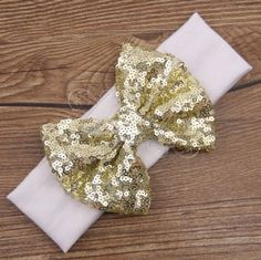"""Made from soft cotton jersey and embellished with a big beautiful 4"""" bow this darling head wraps are a must have in you little fashionista closet... Neutral, hip and cute, these beauties go with any o"""