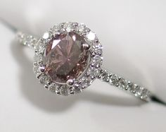 This pink oval diamond is sure to catch plenty of attention especially with the white diamonds around it