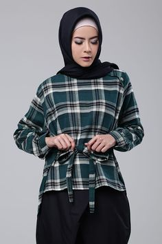 Button Plaid Top from KIMI Indonesia. Deep green colour with cute bow accent in the front.
