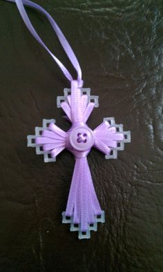 Just a classic.  Ribbon and plastic canvas cross.   It looks as if this one cas been made into a necklace.