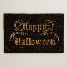 Black Happy Halloween Doormat at Cost Plus World Market - A fun way to spruce up your entryway for Halloween with this eco-conscious doormat >> #WorldMarket Halloween #HalloweenDecor #HalloweenEntertaining