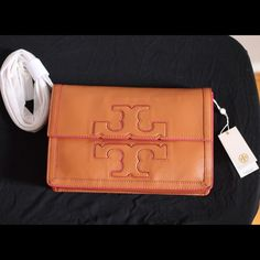 Tory Burch Jessica Square Messenger BRAND NEW- Never used Tory Burch Luggage Messenger. Includes: straps-never opened, Tory Burch Fabric Bag to store your Tory. Message me for any additional questions! Price is negotiable! Tory Burch Bags Crossbody Bags