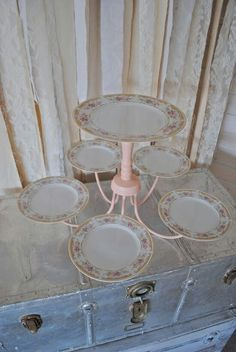 I really like this idea. I have several old plates passed down from family members.