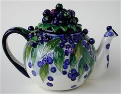 blueberry teapot-I have this one. It is made by the artist who created the wedding cake for Charles and Diana.Lovely