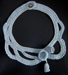 Gray crochet necklace .