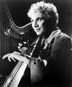 Harpo Marx on his harp (1888 - 1964)
