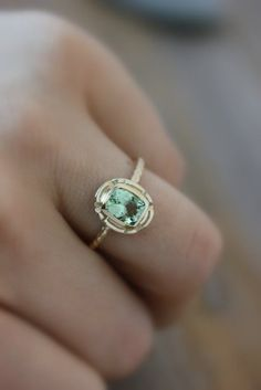 I'm really into colored rings right now! The mint one is nice, but can you imagine that setting with a ruby? Spectacular
