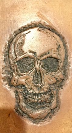 Trying some leather tooling- tooled leather skull