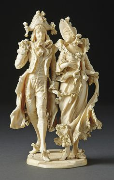 Noble couple. France, late 19th century. Ivory, full-round carved.  H. 21cm.