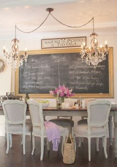 Interesting shabby chic dining room. Chalkboard would definitely keep the young ones occupied while the adults converse after dinner>