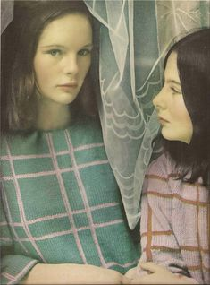 Photo by Saul Leiter, Harper's Bazaar, 1963, Nives Egan and her sister, Colette, in a window of Dublin's