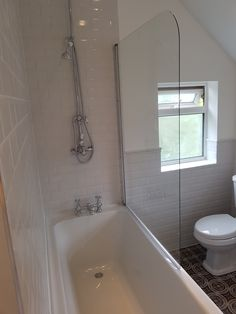 Bathtub and shower in the new bathroom