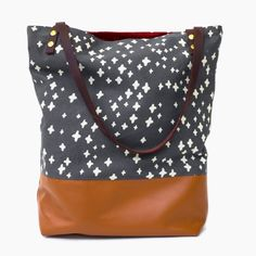 Adorable swiss cross pattern on this leatherblocked tote. www.mooreaseal.com