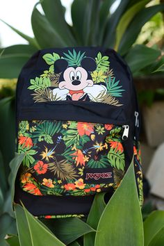 The gang's all here. Introducing the first ever collaboration between Disney and JanSport. Shop the Disney Tropical Mickey High Stakes backpack at select retailers and jansport.com