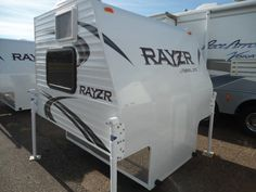 2016 New Travel Lite RAYZR FK Truck Camper in Wisconsin WI.Recreational Vehicle, rv, WOW! A FULL KITCHEN! ONE PIECE FIBERGLASS FRONT AND ROOF! LOADED WITH XTRAS LIKE...A/C AND WAER HEATER ,12000 BTU FURNACE,FRIDGE,STEREO,PORTA POTIE,OUTSIDE SHOWER HEAD, AND MORE!! ONLY 1,115 LBS!! FITS ANY FULL SIZE TRUCK! CHECK OUT THESE PICS...