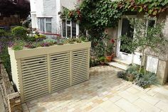 Urban Garden Design We now have to accommodate three large wheelie bins in our front gardens in Barnet and rather than have to look at them every day I set about designing a stora Bin Shed, Outdoor Trash Cans, Roofing Options, Green Facade, Garden Screening, Screening Ideas, Bamboo Screening, Small Sheds, Front Gardens