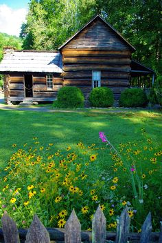Historic farm house in the Great Smoky Mountains National Park in North Carolina - at Mountain Farm Museum. Guide: http://www.romanticasheville.com/greatsmokymountains.htm