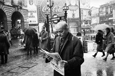A Man reading a Paper at Piccadilly Circus Central London England in 1963