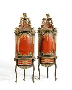 A PAIR OF SUMPTUOUS BAROQUE CORNER CABINETS Italy, ca. 1720   Carved and polychromed wood. Console-like lower section on high legs with one frieze drawer. One-doored upper section with open worked crest and high etagère. The front is sumptuously decorated with scrolls, acanthus, shells, blossoms, festoons and ribbons. 226 x 74 x 54 cm. Condition C.   Literature:  Silvano Colombo: L'Arte Del Legno E Del Mobile In Italia, Busto Arsizio 1981. For the carved decor cf. ill. 466.