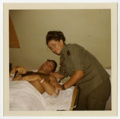 Diane Kay Corcoran tends to a male patient at 24th Evacuation Hospital in Long Binh, Vietnam.