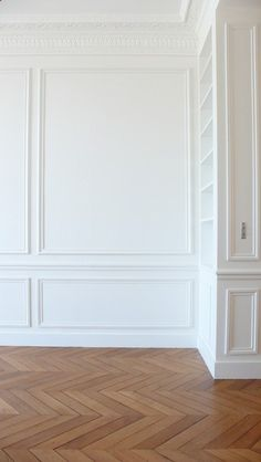 Herringbone floors white moulding.