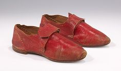 This scarce pair of 18th century child's shoes incorporates the pointed toe and tongue found in fashionable women's styles, combined with the flat heel suitable for a child. It is not clear from the cut whether these shoes would have been worn by a boy or a girl, but the bright color is more suggestive of feminine dress.