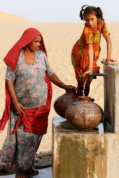 The state of Rajasthan is one of the driest in India. Access to drinking water often means a very long walk for women and children in the desert. We Are The World, People Around The World, Rajasthan India, Jaipur, Beautiful Children, Beautiful People, Amazing India, India People, Mother And Child