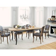 These elegant grey taupe dining chairs fit perfectly with a nautral wood table.