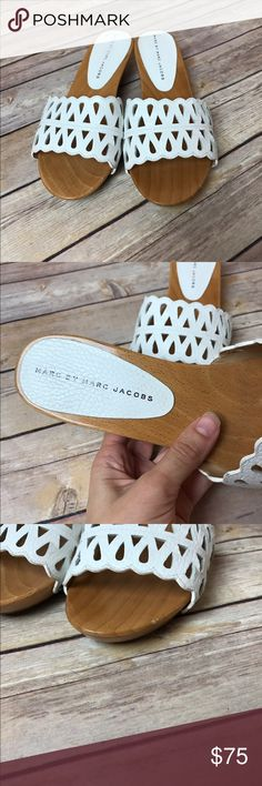 "Marc by Marc Jacobs Perforated Slip On Sandals Women's Marc by Marc Jacobs White Slip on Wedge Sandals  2"" wedge. Size Eur 37 which equals a U.S. size 7.  MSRP $278 Great condition. Slight wear on inner sole, chip on front left, scuff on back left.  Permanent marker on bottom sole. Please see pictures for details.  Smoke free home Marc by Marc Jacobs Shoes Sandals"